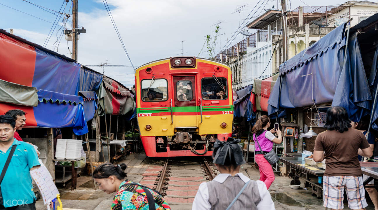 train in maeklong railway market